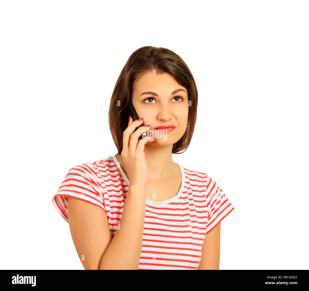 disgruntled girl talking on mobile phone. look with perplexity. emotional girl isolated on white background. - Stock Image