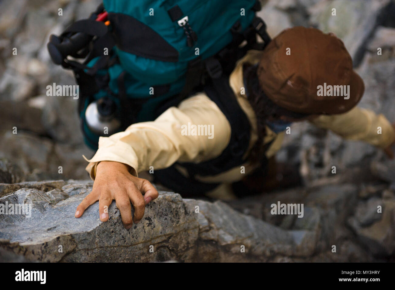Clutching for a handhold during a tough climb up to Nydiver Lake in the Ansel Adams wilderness and Inyo national forest near the PCT - Stock Image