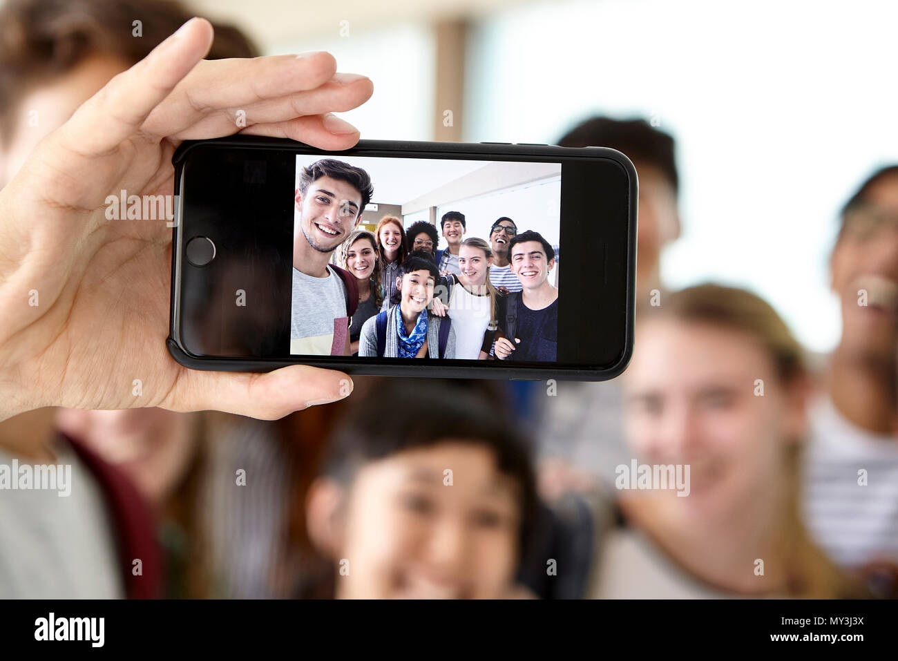 School friends posing together for selfie - Stock Image