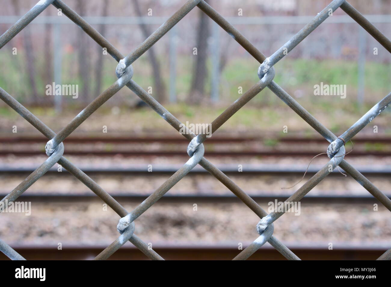 A fence along a railway track. - Stock Image