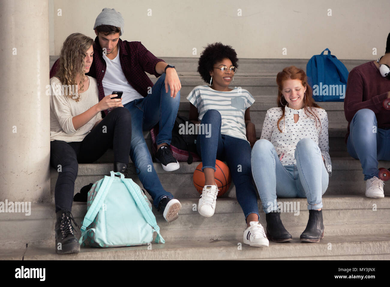 Friends hanging out together during break at school - Stock Image
