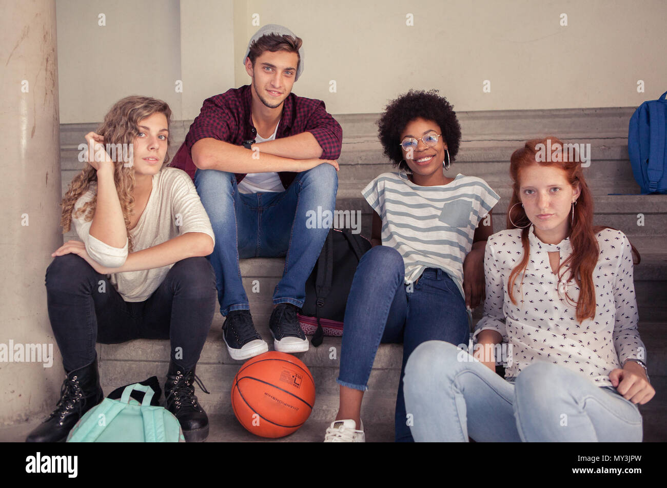 Group of friends hanging out together after school, portrait - Stock Image