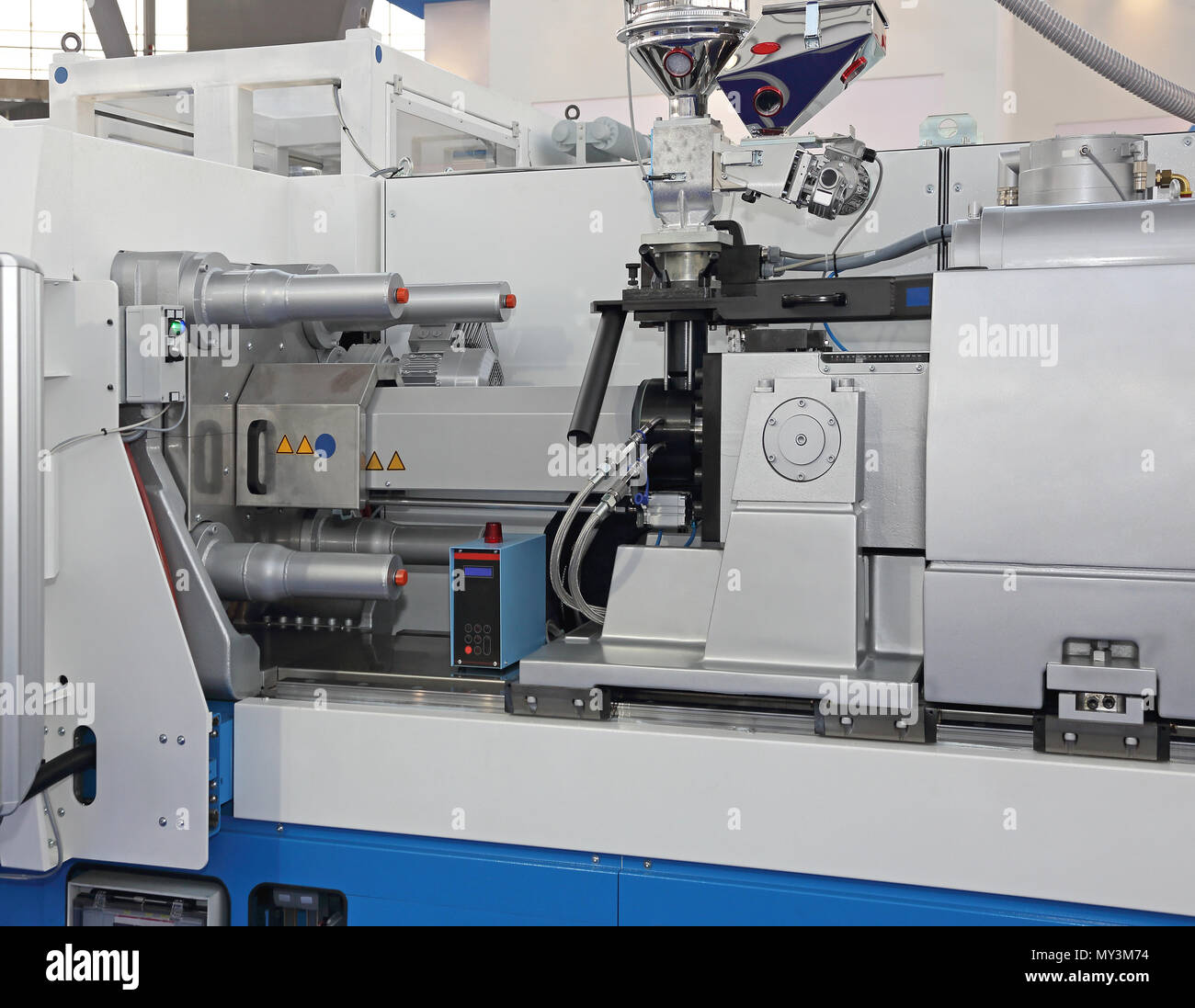 Injection Molding Machine for Plastic Parts Production - Stock Image