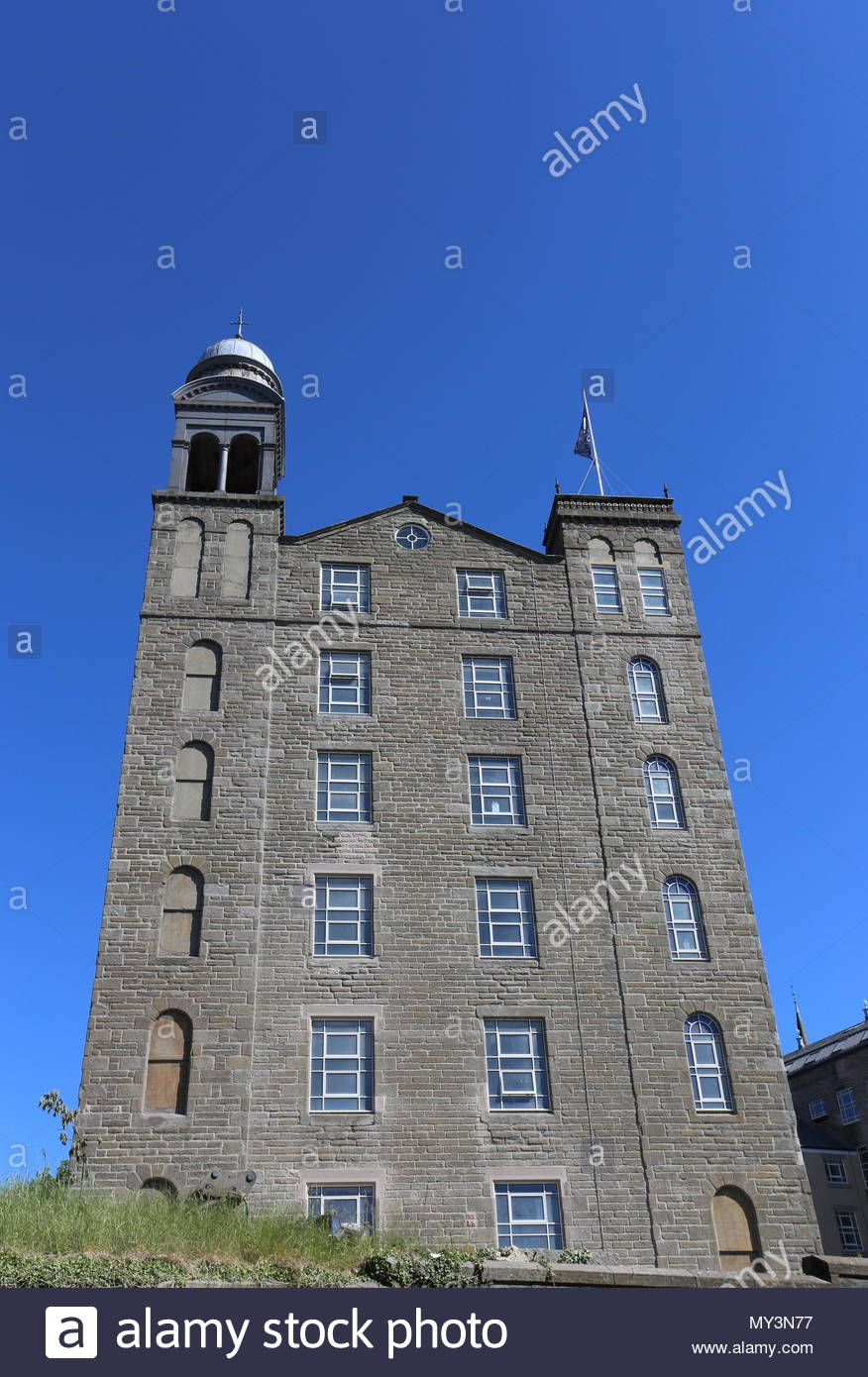 Former Baxter Brothers Mills being refurbished into Hotel Indigo with flag Dundee Scotland  June 2018 - Stock Image
