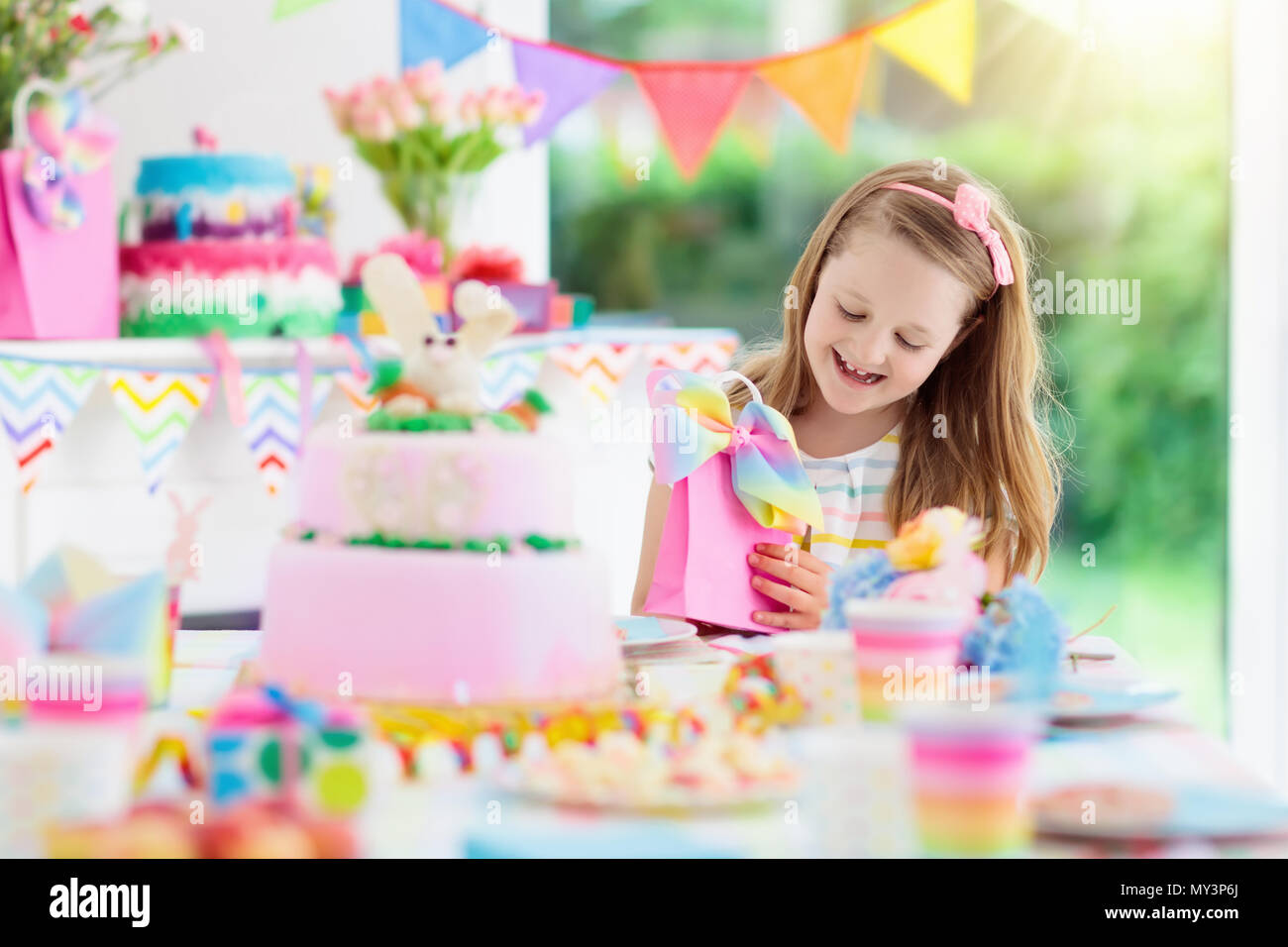 Kids Birthday Party With Colorful Rainbow Pastel Decoration And Bunny Layer Cake Little Girl Sweets Candy Fruit Balloons Banner At Fes