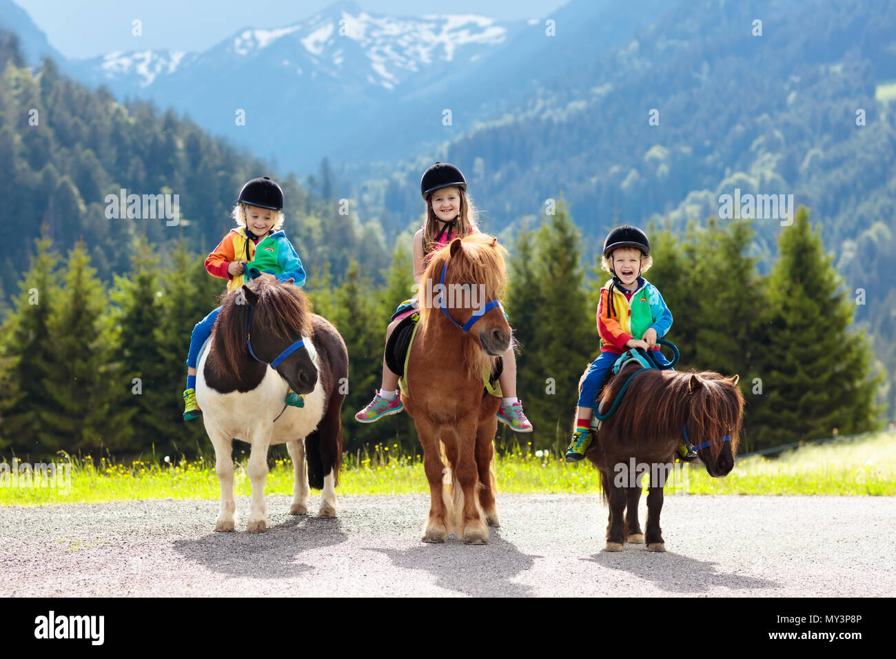 Kids Riding Pony In The Alps Mountains Family Spring Vacation On Horse Ranch Austria Tirol Children Ride Horses Kid Taking Care Of Animal Chil