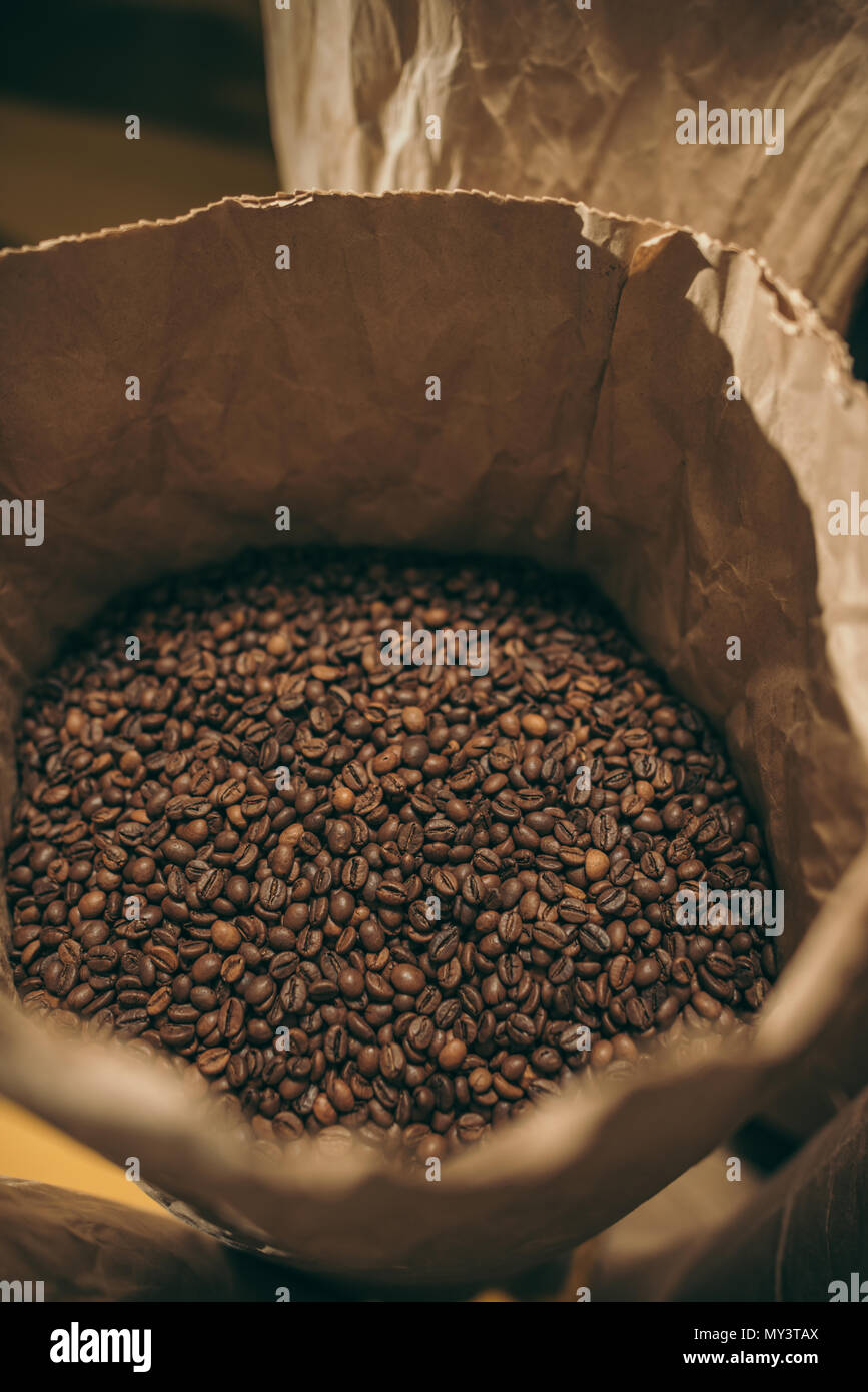 close up view of coffee beans in paper bag Stock Photo