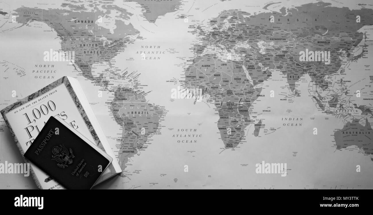 A world map with a travel planning book and us passport a world map with a travel planning book and us passport photographed from above in black and white gumiabroncs Gallery