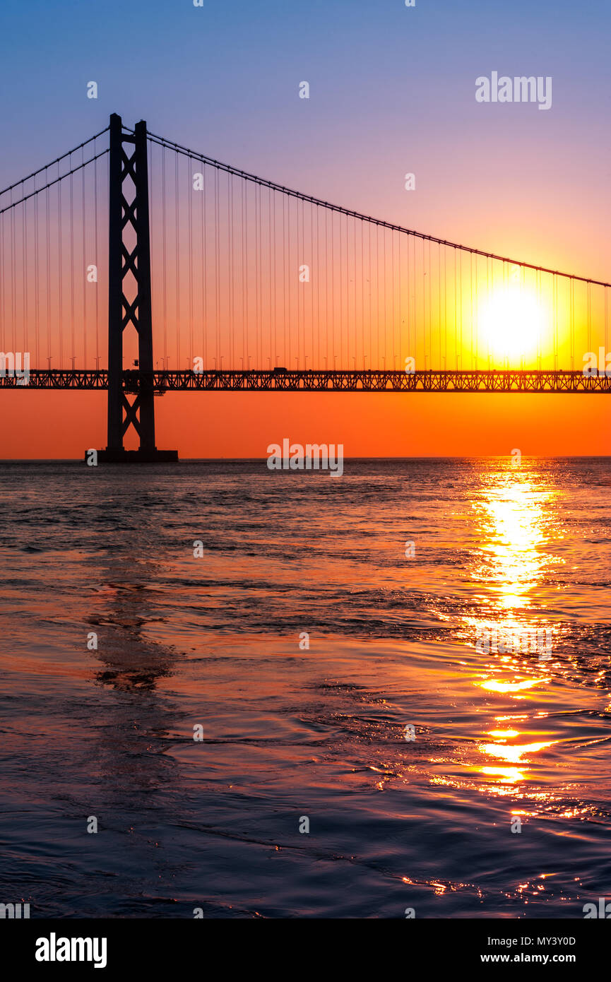 sunset with Akashi Kaikyo bridge on twilight sky - Stock Image