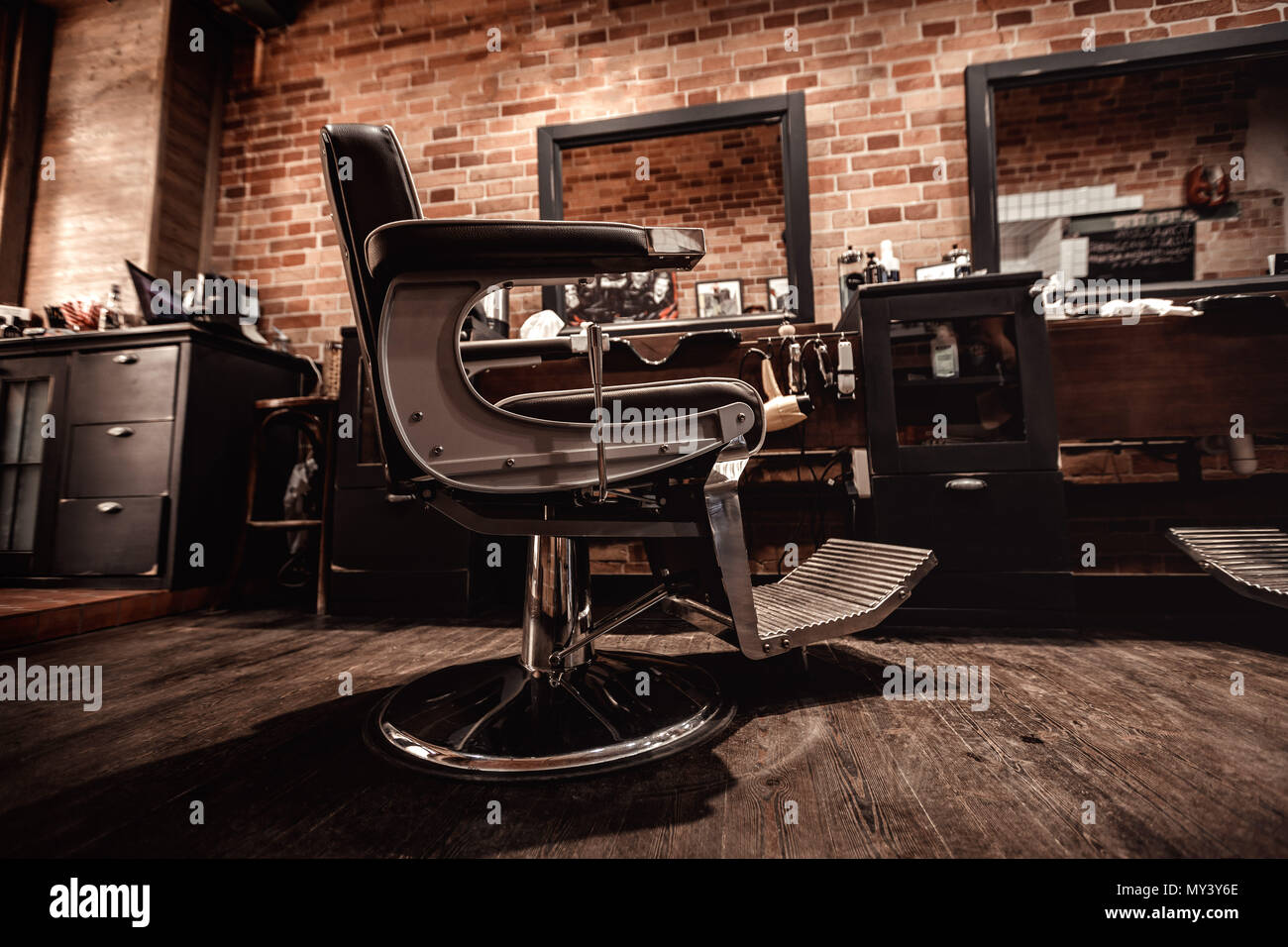 Client's stylish barber chair - Stock Image - Antique Salon Chair Stock Photos & Antique Salon Chair Stock Images