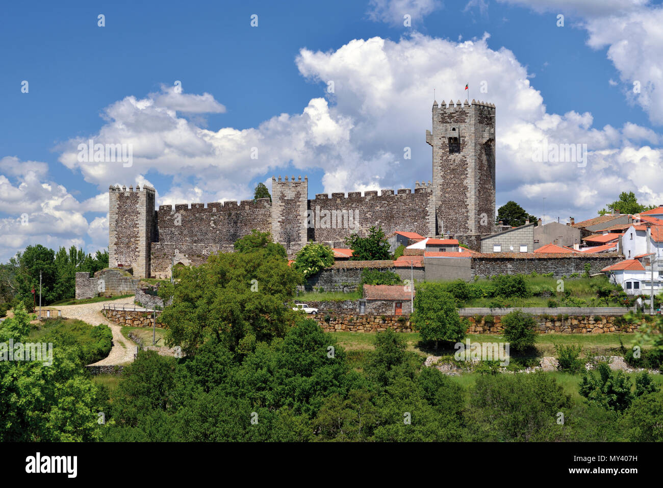 View to medieval castle with white couds in front of babyblue sky - Stock Image