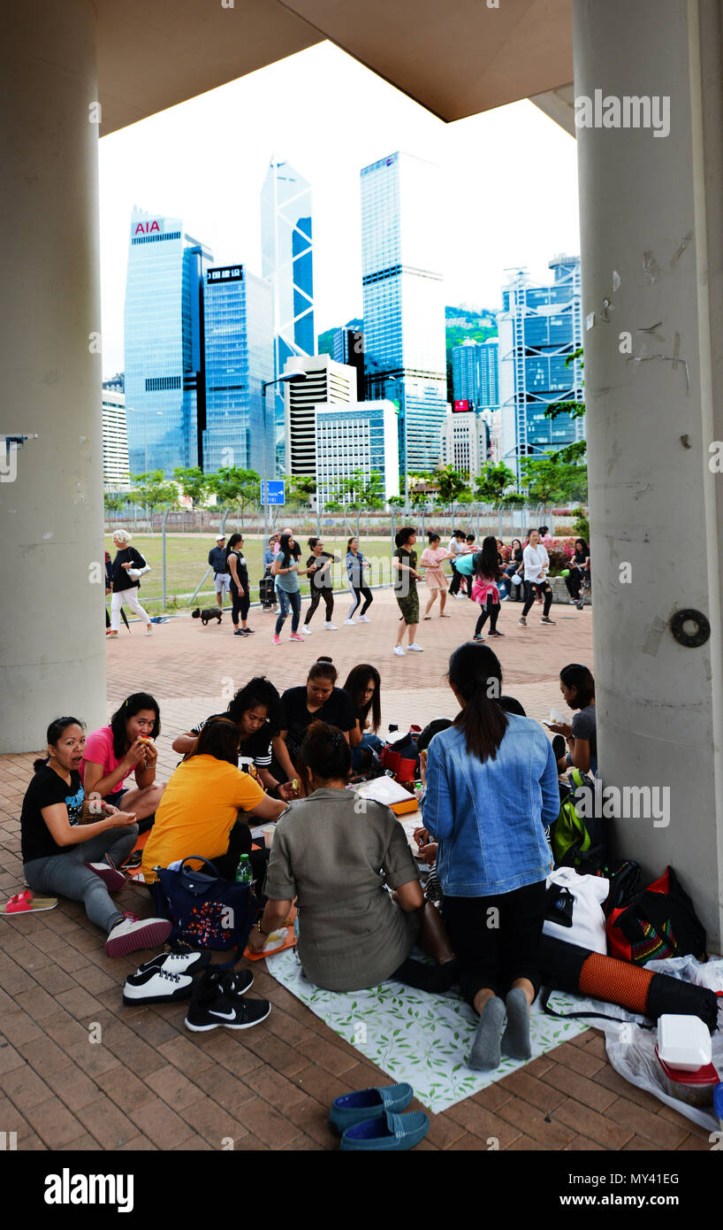 Filipino domestic helpers socializing on their Sunday day off in 'Central' , Hong Kong. - Stock Image