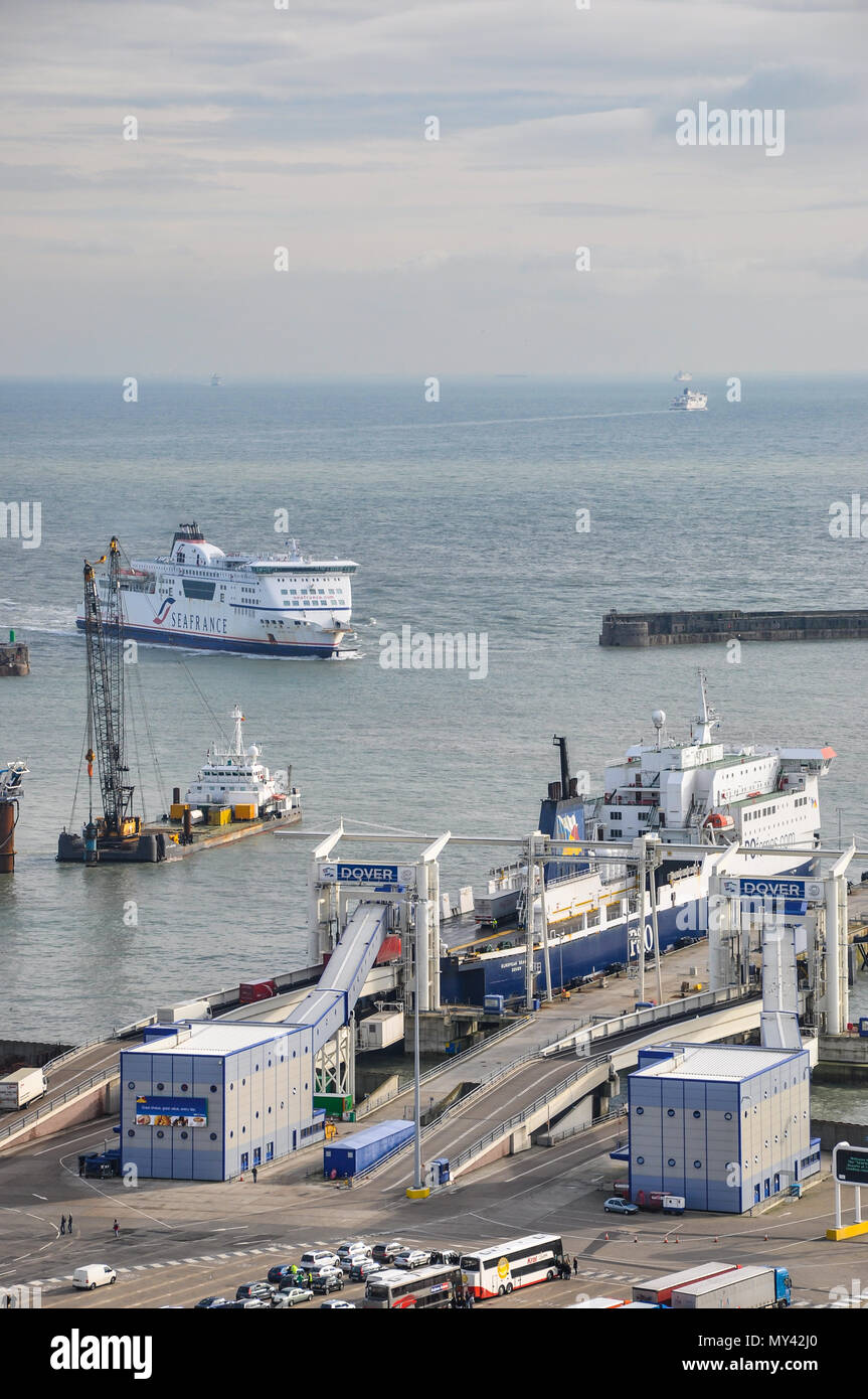 Sea France ferry entering Port of Dover harbour. P&O ferry in dock loading up with lorries, trucks, with others in queue. Portrait. Ferries in Channel Stock Photo