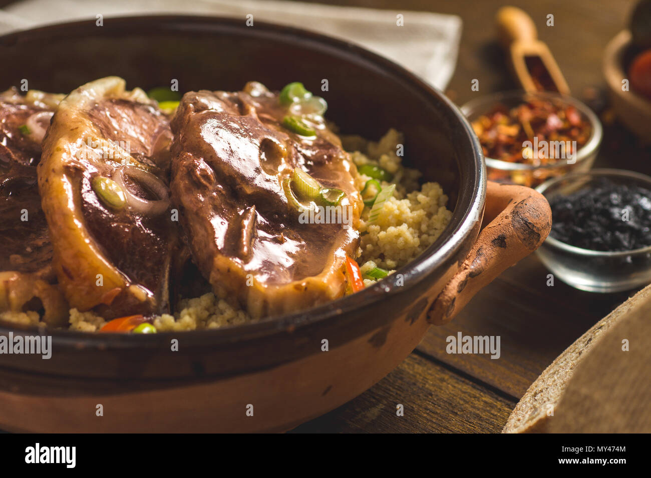 Roasted Lamb Loin Chops with Couscous and Soybean in Rustic Clay Dish - Stock Image