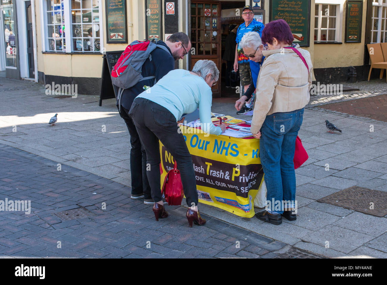 People signing a petition in support of the NHS in Ramsgate, Kent, England, UK. - Stock Image