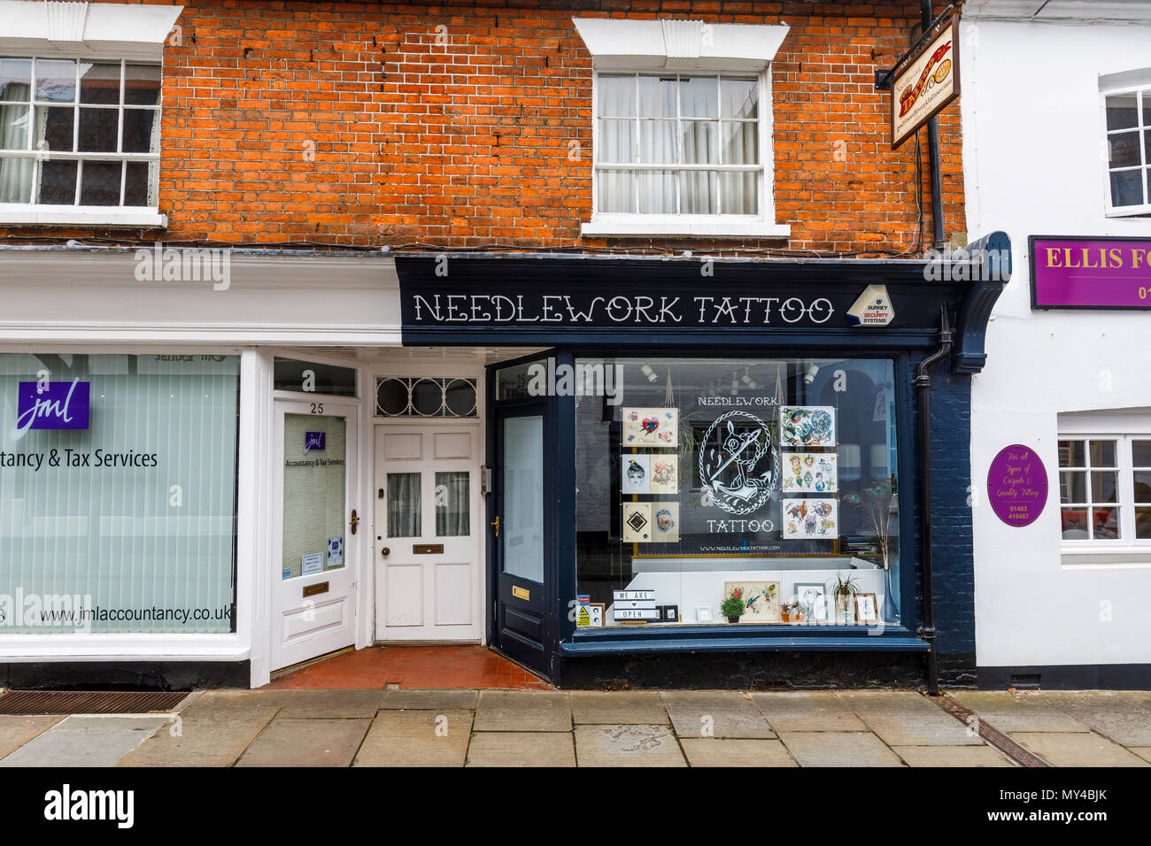 Needlework Tattoo, a tattoo parlour shop for tattooing in Godalming, a small historic market town near Guildford, Surrey, southeast England, UK - Stock Image