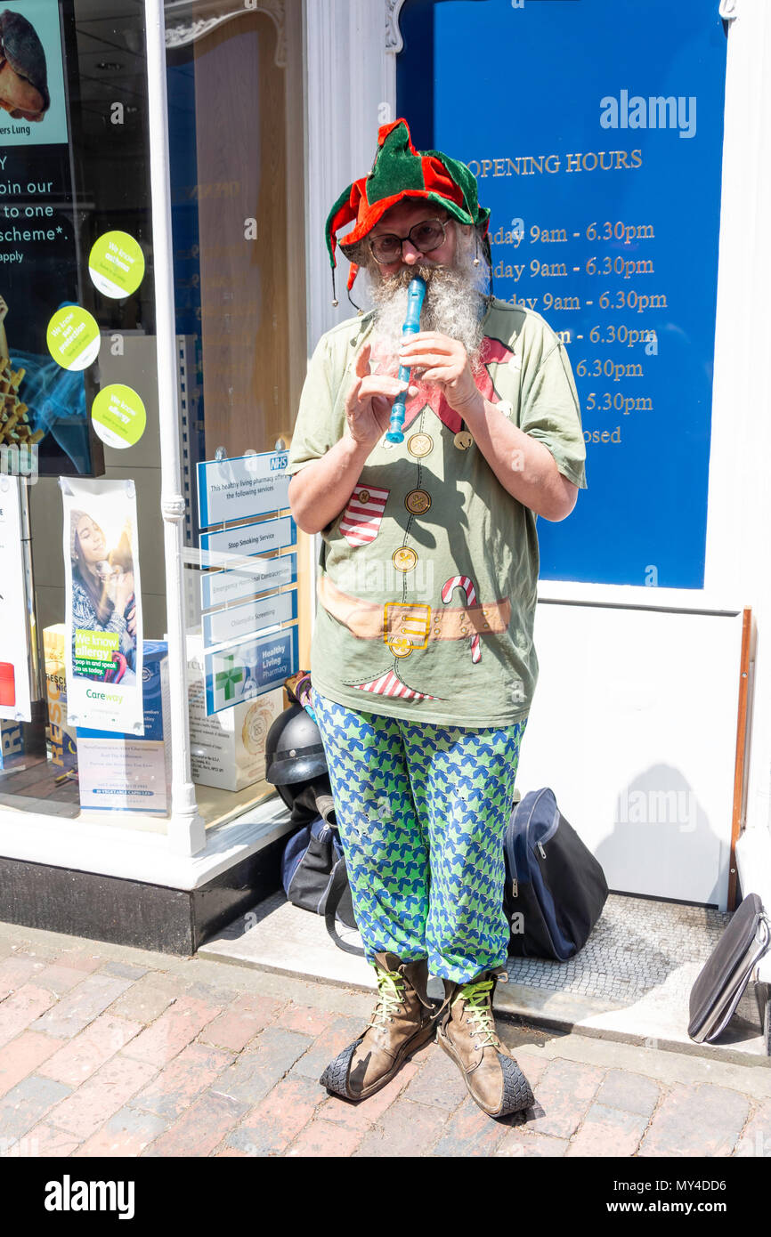 Busker playing flute, The Pantiles, Royal Tunbridge Wells, Kent, England, United Kingdom - Stock Image
