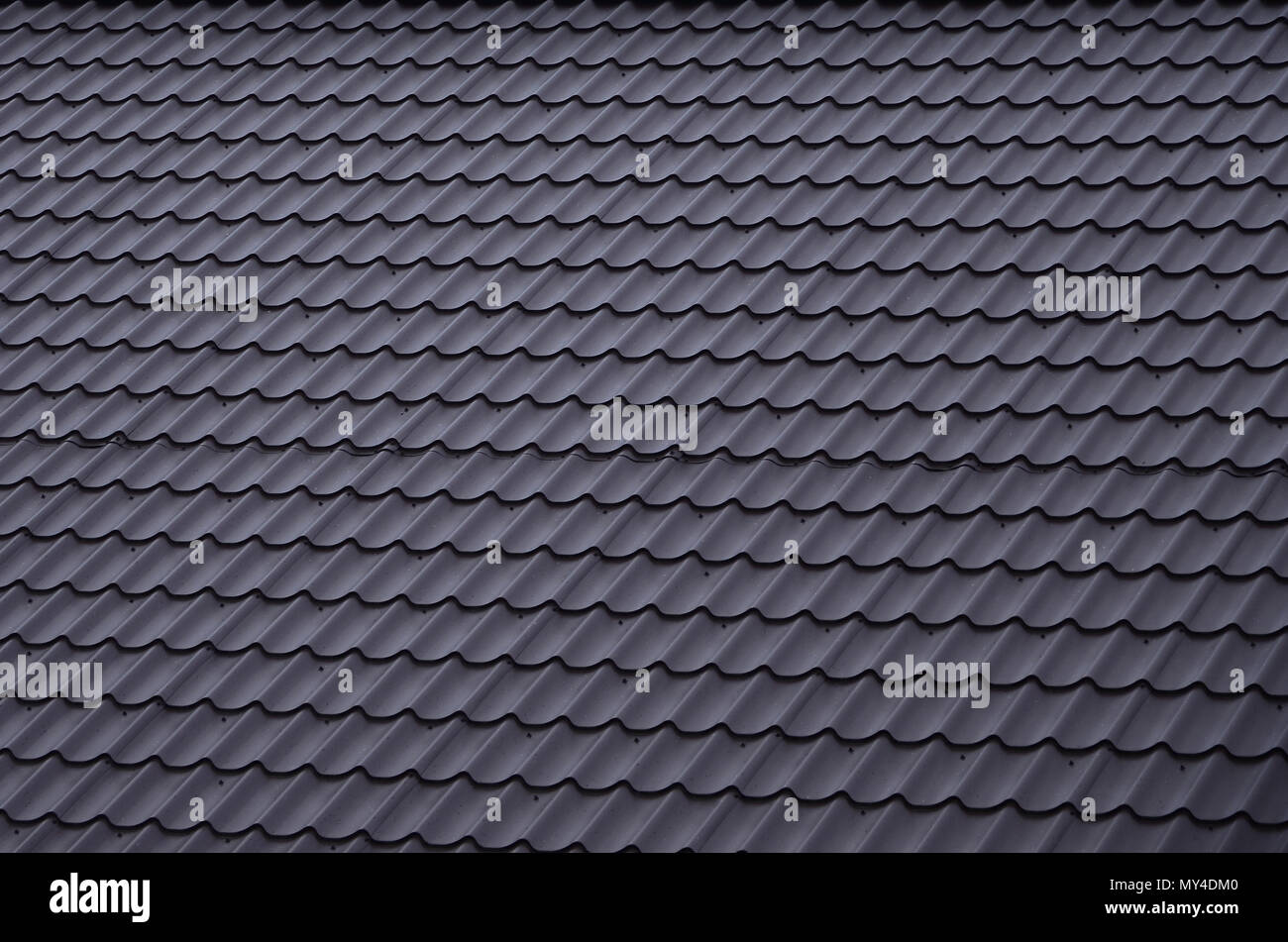the texture of the roof of painted metal close up detailed view of roof covering for pitched roof high quality roofing - Roof Covering