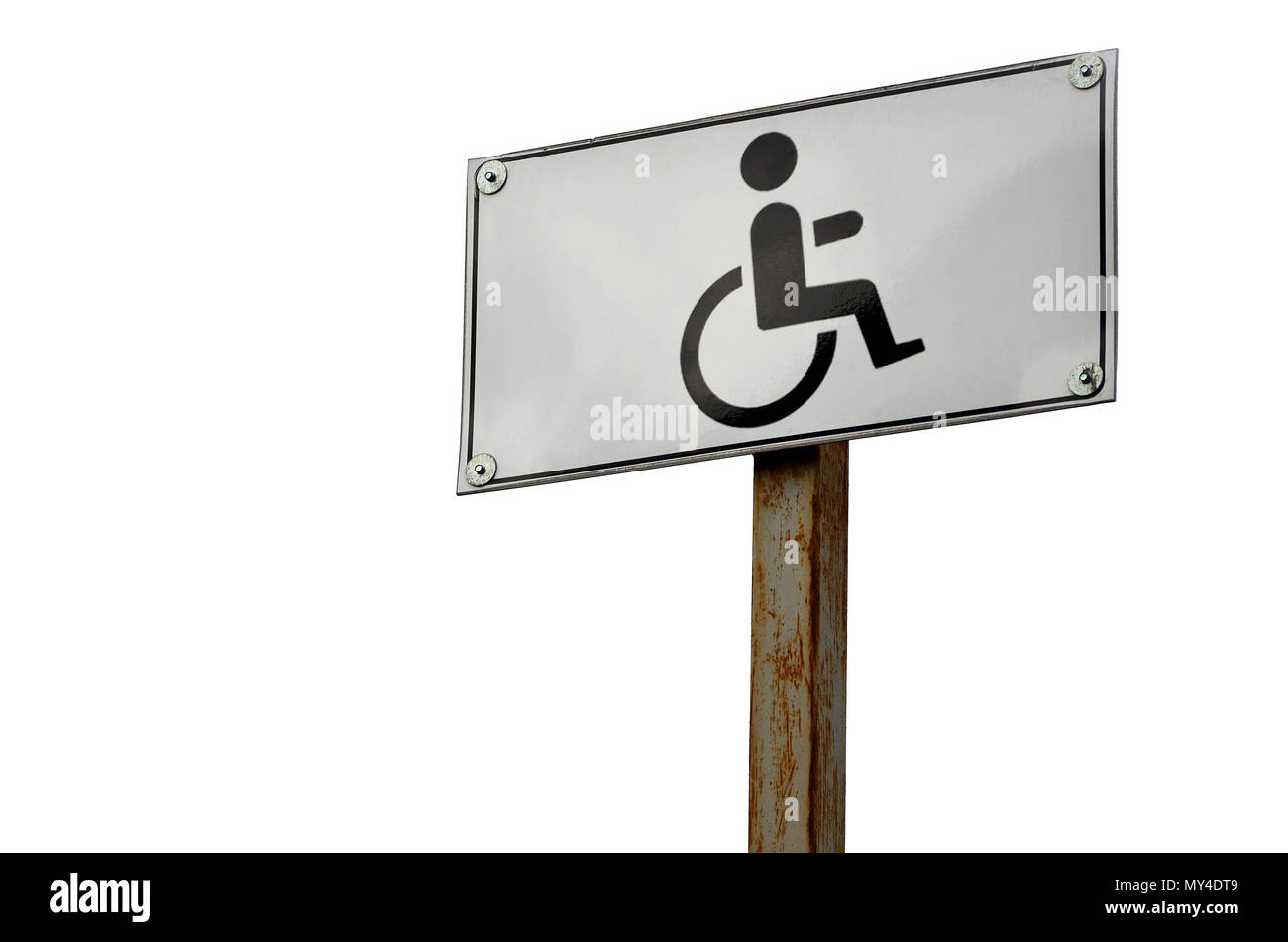A road sign indicating the crossing of a road for disabled people. White road sign with a picture of a man sitting in a wheelchair - Stock Image