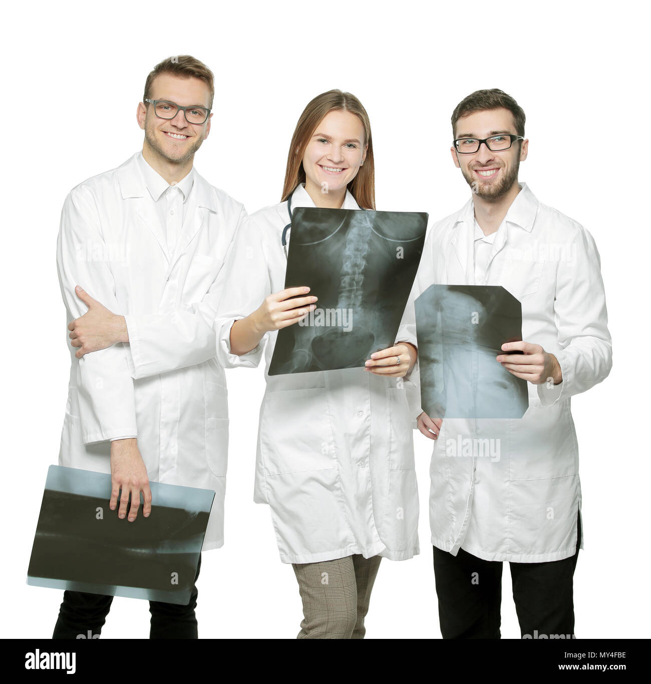 group of smiling doctors with x-rays.isolated on white - Stock Image