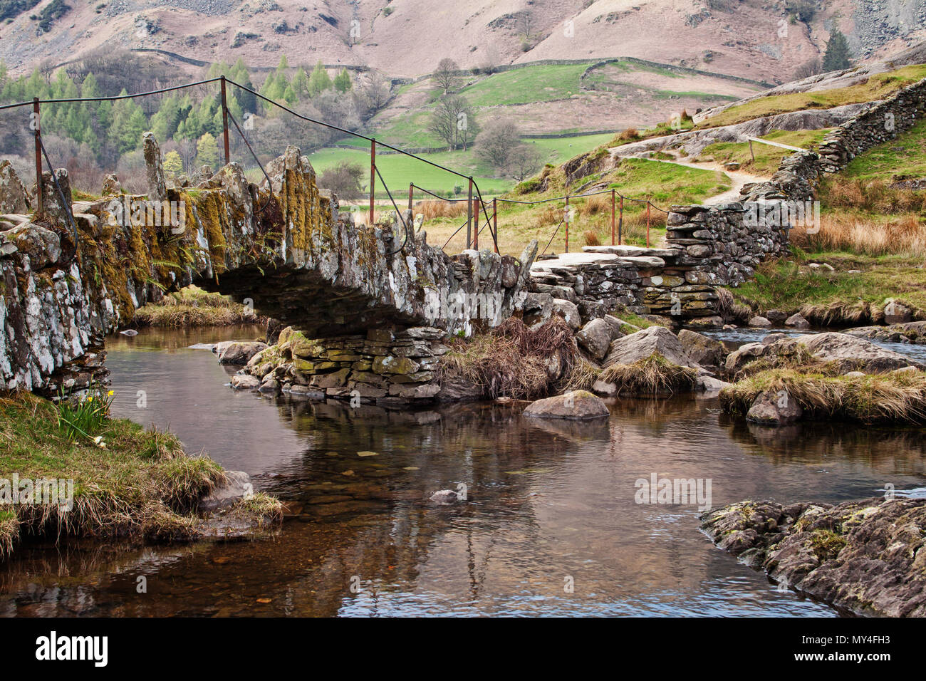 Patterns of construction juxtaposed with nature at Slater Bridge, Little Langdale, Lake District - Stock Image