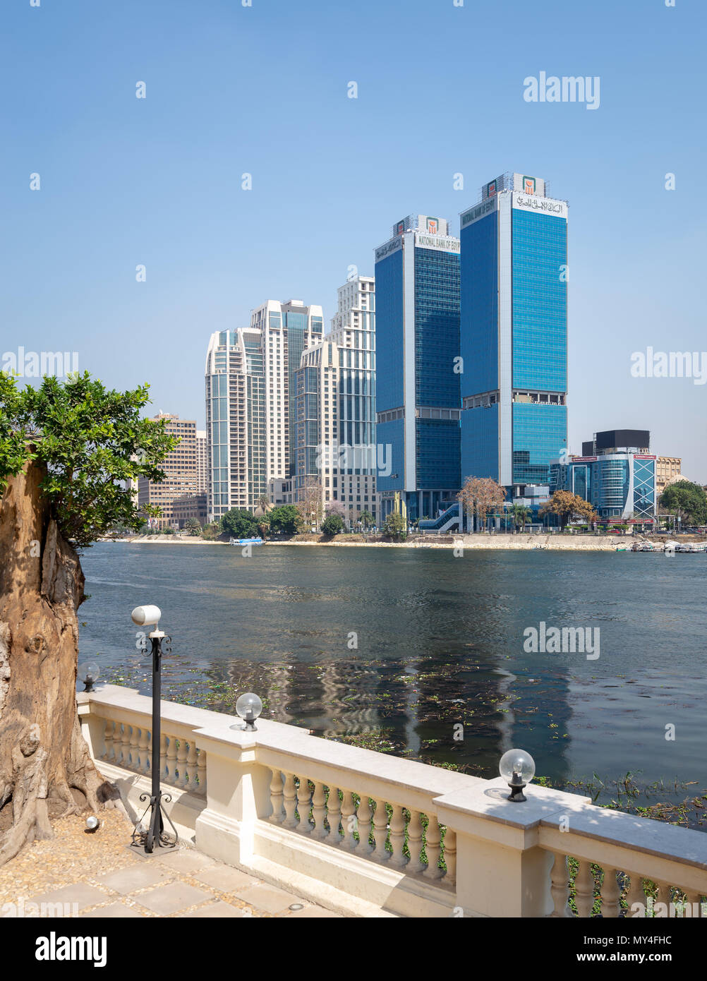 Cairo, Egypt - March 10, 2018: City view from River Nile overlooking Head Office of National Bank of Egypt and St. Regis hotel, Egypt - Stock Image