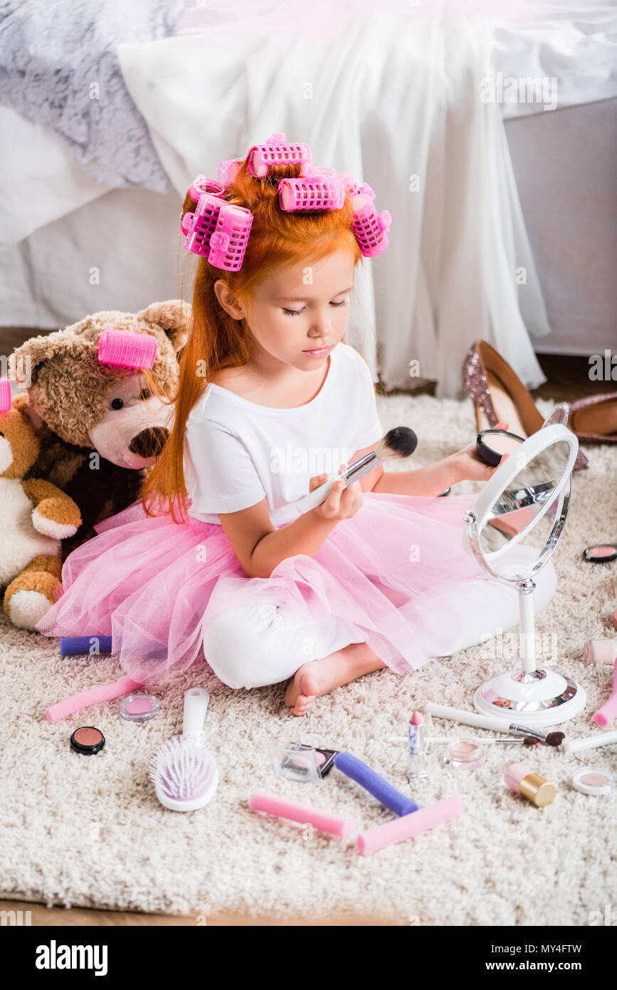 Cute Girl In Tutu Tulle Skirt With Curlers On Head Holding