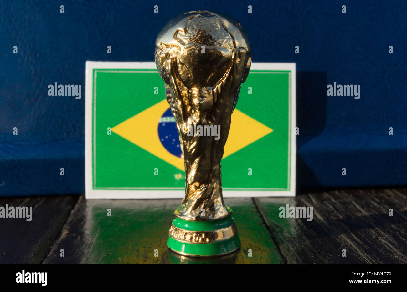 june-6-2018-moscow-russia-fifa-world-cup-trophy-on-the-background-of-the-flag-of-brazil