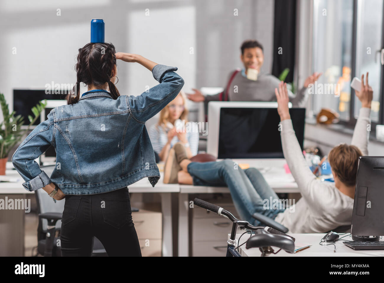 people having fun at modren office - Stock Image