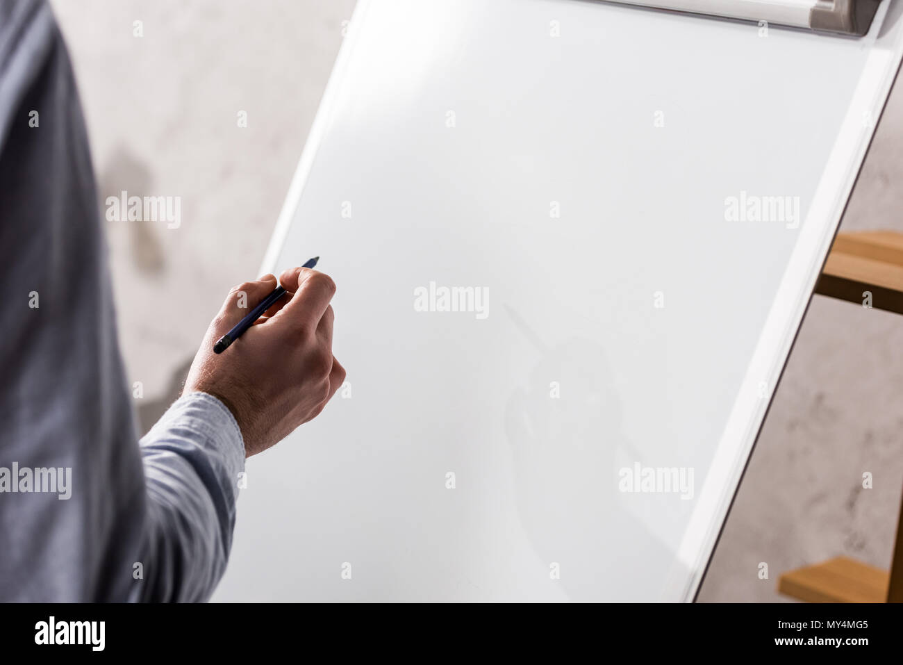 cropped image of businessman writing something on flipchart - Stock Image