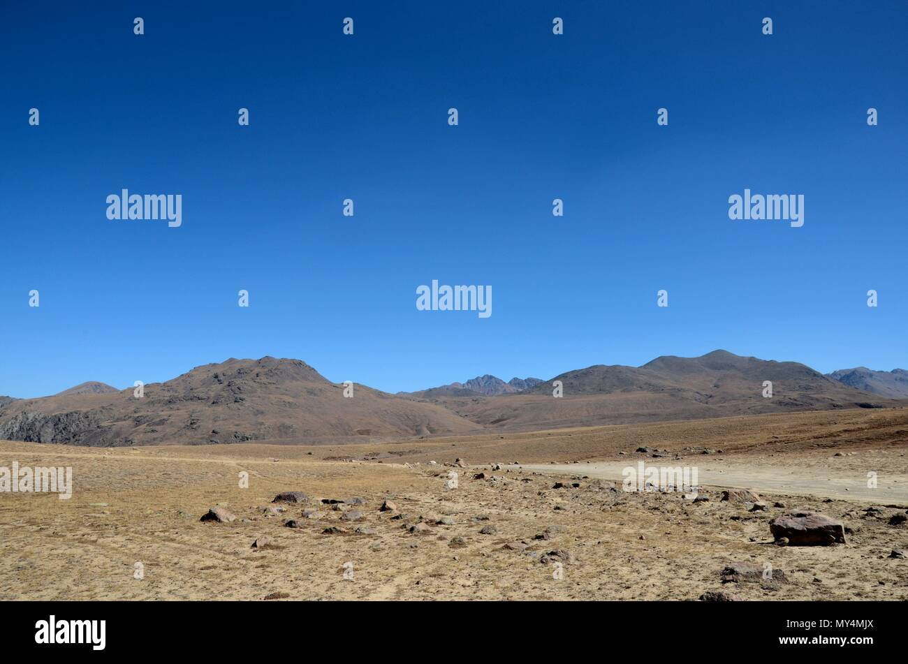 Scientific equipment by deserted and empty road in dry and barren Deosai Plains Gilgit-Baltistan Pakistan - Stock Image