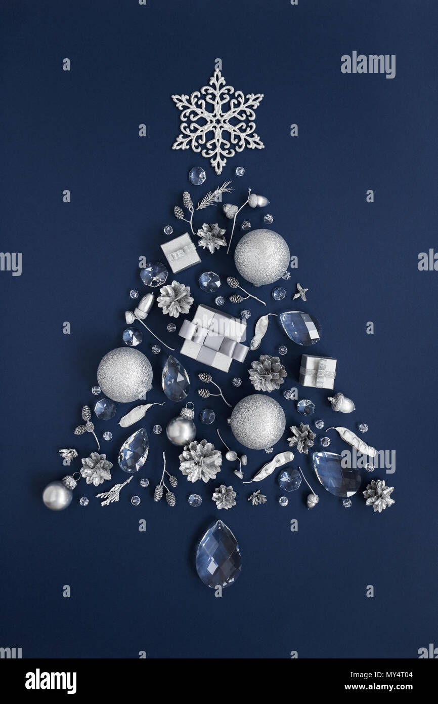 luxury shape of new year tree made of crystal and silver christmas decorations on dark blue background holiday greeting card concept and christmas sy