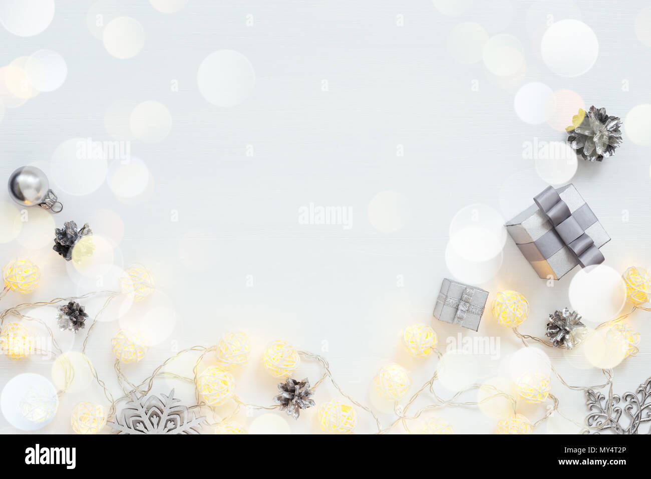christmas lights silver new year decorations gifts snowflakes garland on bright holiday background