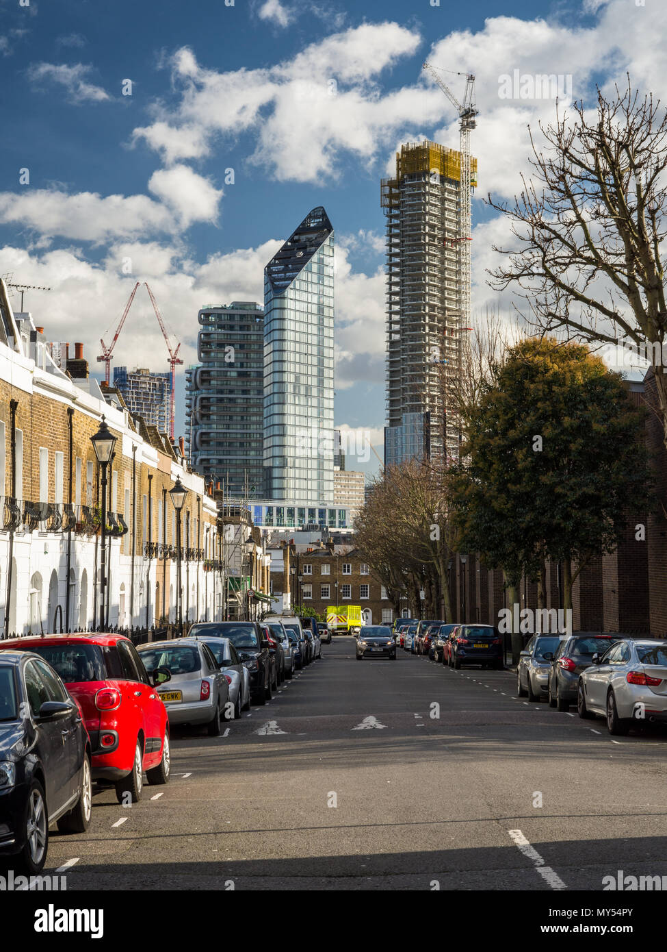 London, England, UK - February 12, 2018: A cluster of new high rise apartment buildings stands with construction partially completed on City Road, wit - Stock Image