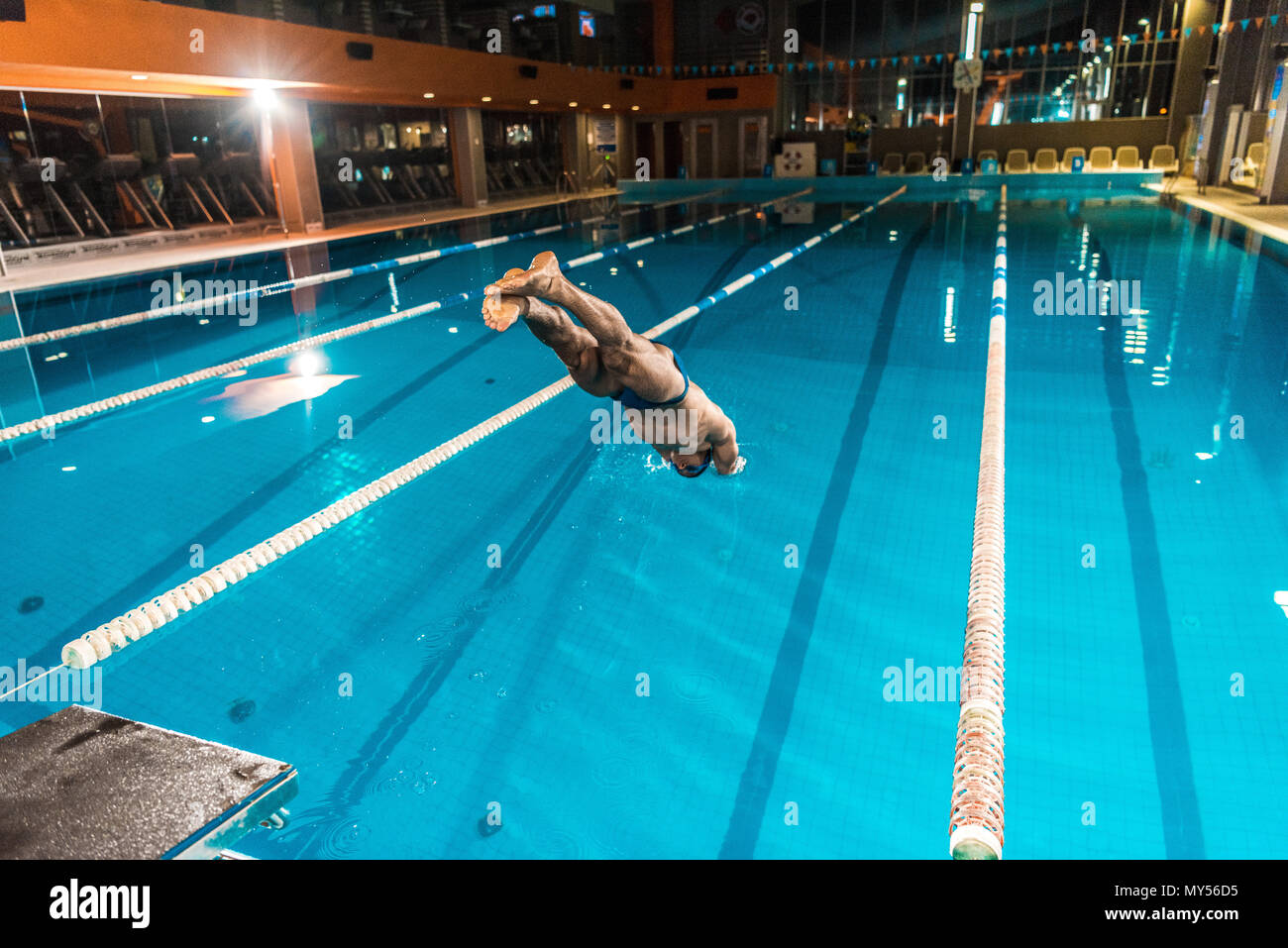 swimmer diving into competition swimming pool - Stock Image