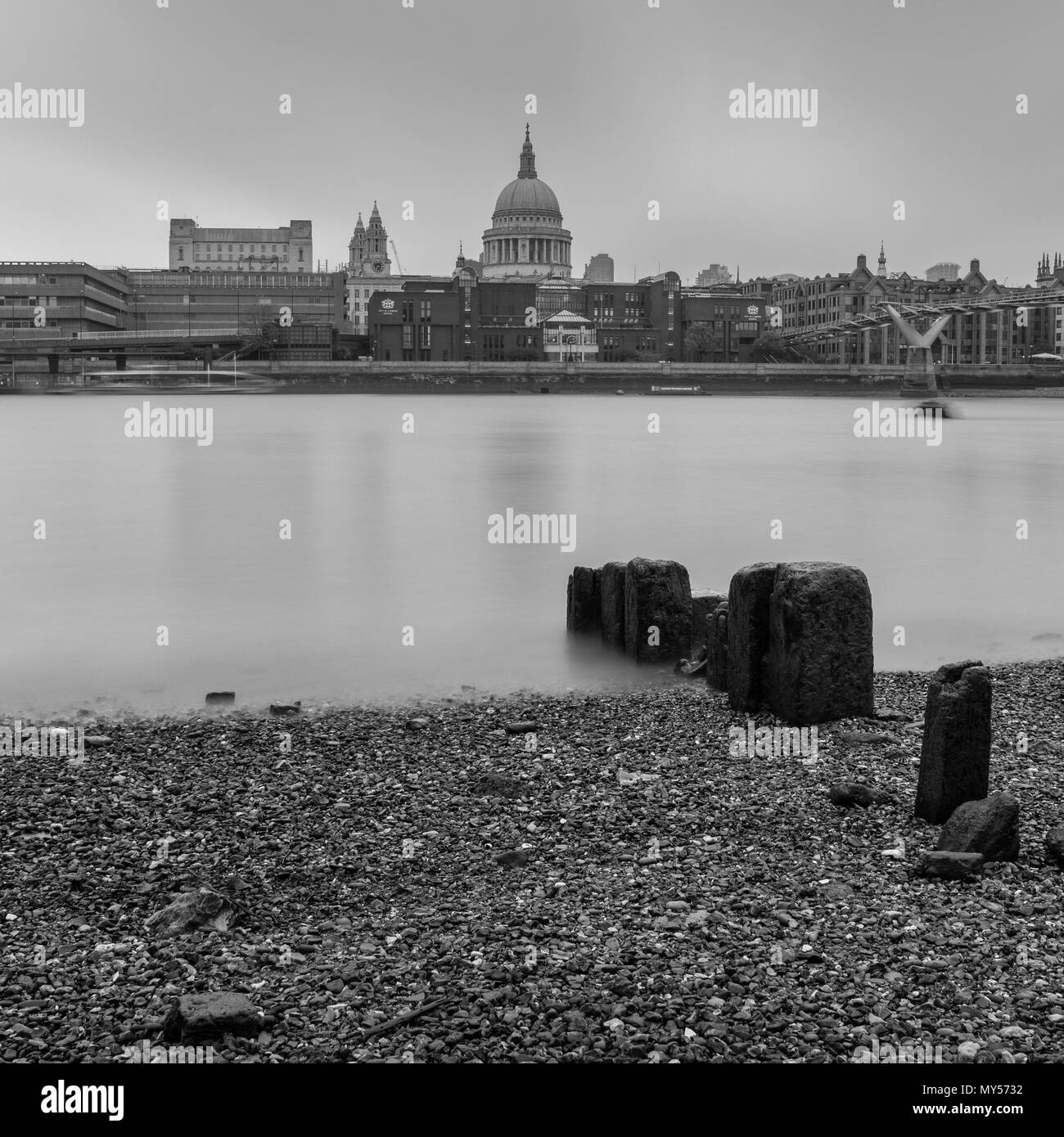 London, England, UK - May 29, 2018: Grey skies and air pollution shroud St Paul's Cathedral and the City of London across the River Thames from Banksi - Stock Image