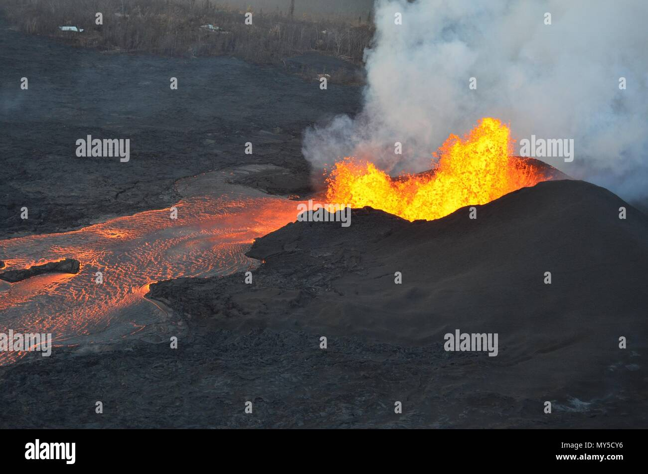 A massive lava fountain spewing magma 160 feet into the air from fissure 8 at the corner of Nohea and Leilani caused by the eruption of the Kilauea volcano June 5, 2018 in Hawaii. The recent eruption continues destroying homes, forcing evacuations and spewing lava and poison gas on the Big Island of Hawaii.Stock Photo