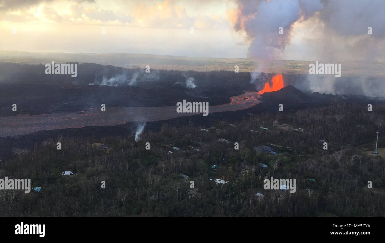 A massive lava fountain spewing magma 160 feet into the air from fissure 8 at the corner of Nohea and Leilani caused by the eruption of the Kilauea volcano June 4, 2018 in Hawaii. The recent eruption continues destroying homes, forcing evacuations and spewing lava and poison gas on the Big Island of Hawaii. - Stock Image