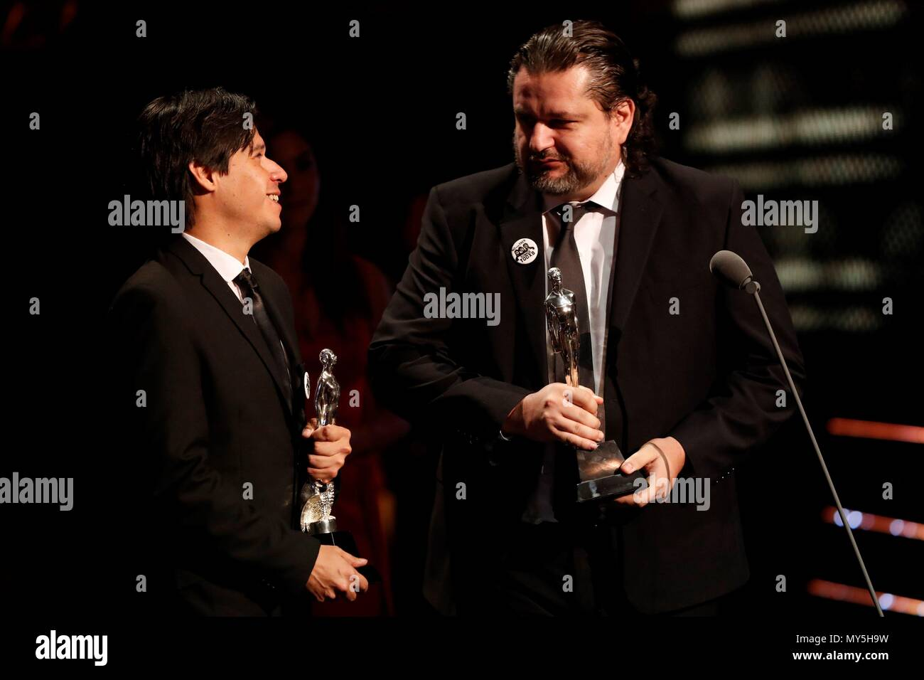 Actor Alexandro Aldrete (L) and writer Diego Enrique Osorno receive their Arial Award to the Best Short Documentary Film for 'La Muneca Tetona' during Mexico's 60th Ariel Film Awards handover ceremony held in Mexico City, Mexico, 05 June 2018 (issued on 06 June). EFE/ Mario Guzman - Stock Image