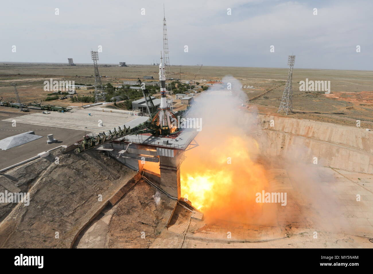 Kazakhstan. 06th June, 2018. KYZYLORDA REGION, KAZAKHSTAN - JUNE 6, 2018: A Soyuz-FG rocket booster carrying the Soyuz MS-09 spacecraft with the ISS Expedition 56/57 prime crew members, European Space Agency (ESA) astronaut Alexander Gerst, Roscosmos cosmonaut Sergey Prokopyev, and NASA astronaut Serena M. Aunon-Chancellor, aboard blasts off to the International Space Station from the Baikonur Cosmodrome. Sergei Savostyanov/TASS Credit: ITAR-TASS News Agency/Alamy Live News - Stock Image