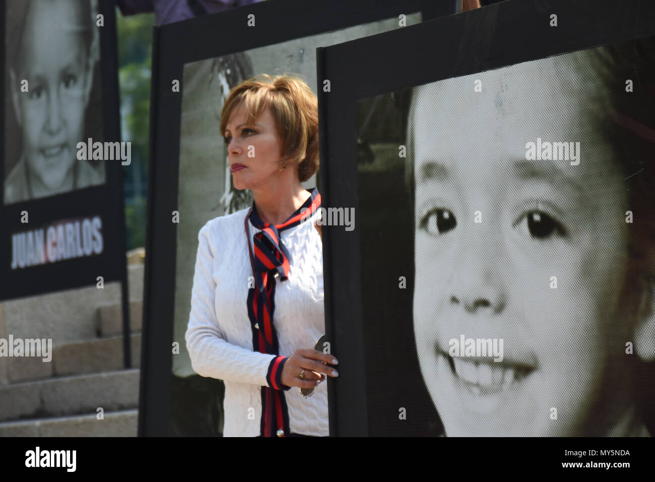 Mexico City, Mexico. 5th June, 2018. Relatives holding portraits of the deceased during the 9th anniversary protest. Demonstration to the impunity and corruption of the Government during the 9 years after the tragedy on 05, June 2009. 25 little girls and 24 little boys died as a result of a fire in the ABC Nursery in Hermosillo, Sonora. Eduardo Bours was the governor. Credit: Carlos Tischler/SOPA Images/ZUMA Wire/Alamy Live News Stock Photo