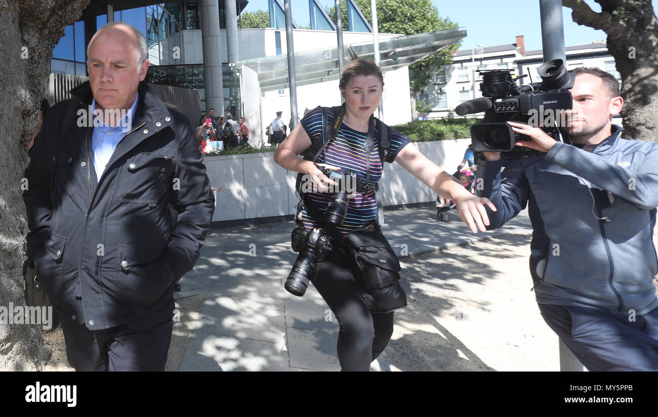 Dublin, Ireland. 6th June. 2018. David Drumm found guilty. The media scramble to get images of David Drumm as he is pictured leaving court in Dublin today. The former Anglo Irish chief was found guilty on two counts of fraud, and has been remanded on bail until June 20th for sentencing. Photo: Leah Farrell/RollingNews/Alamy Live News - Stock Image