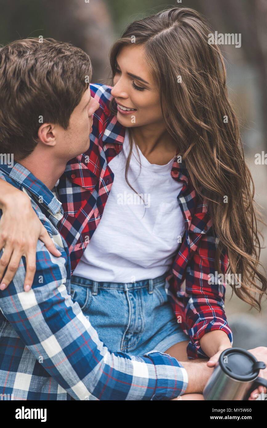 young happy couple spending time on nature - Stock Image