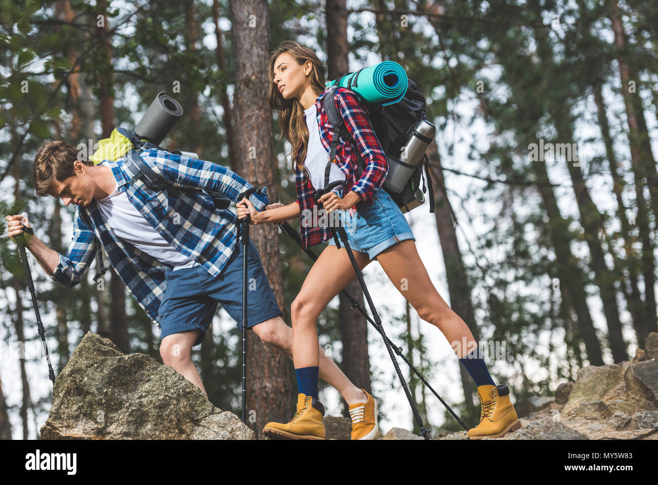 exhausted young couple on hiking trip - Stock Image