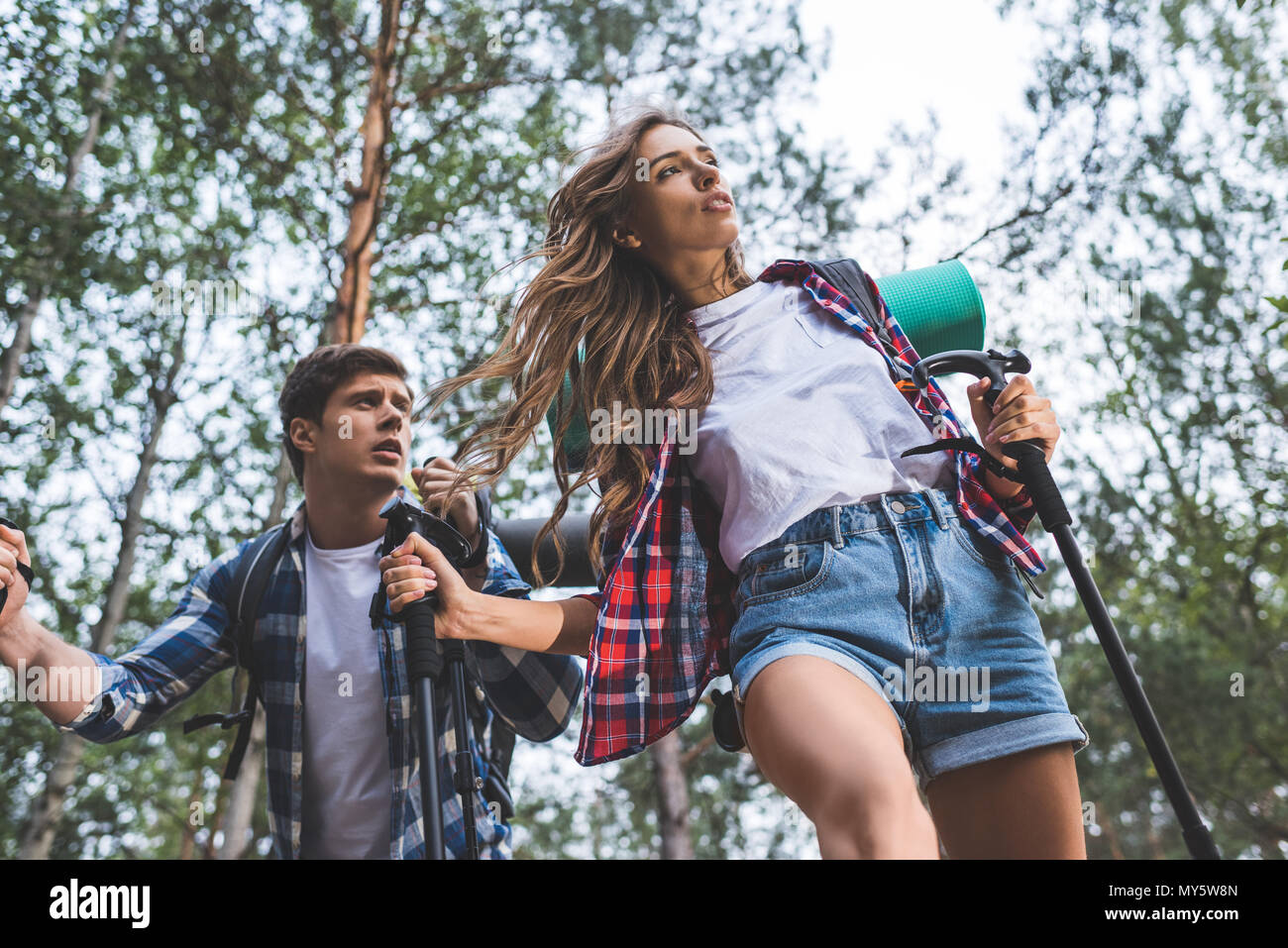bottom view of exhausted couple on hiking trip - Stock Image