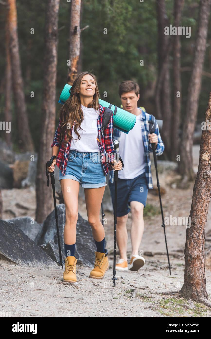 beautiful active couple with trekking poles having trip - Stock Image