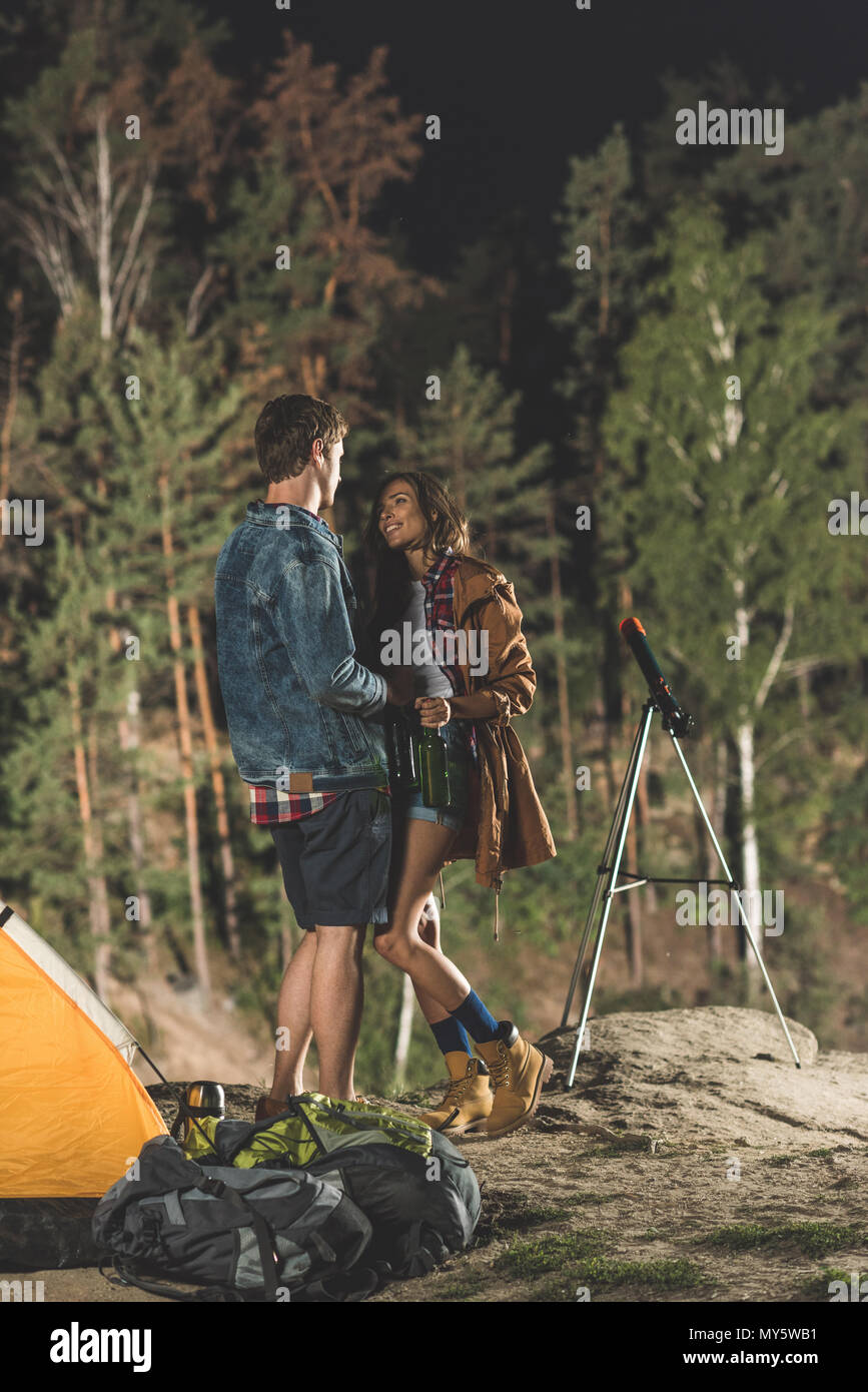 young loving couple on hiking trip looking at each other - Stock Image