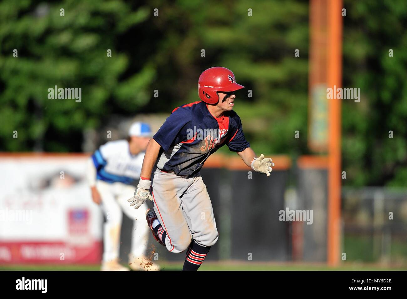 Runner taking a secondary lead prior to advancing from second to third base. USA. - Stock Image