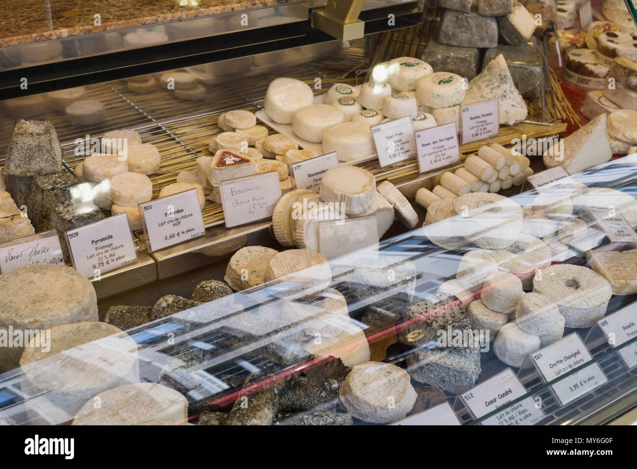 Cheese on display in a Paris cheese shop (fromagerie), France. - Stock Image