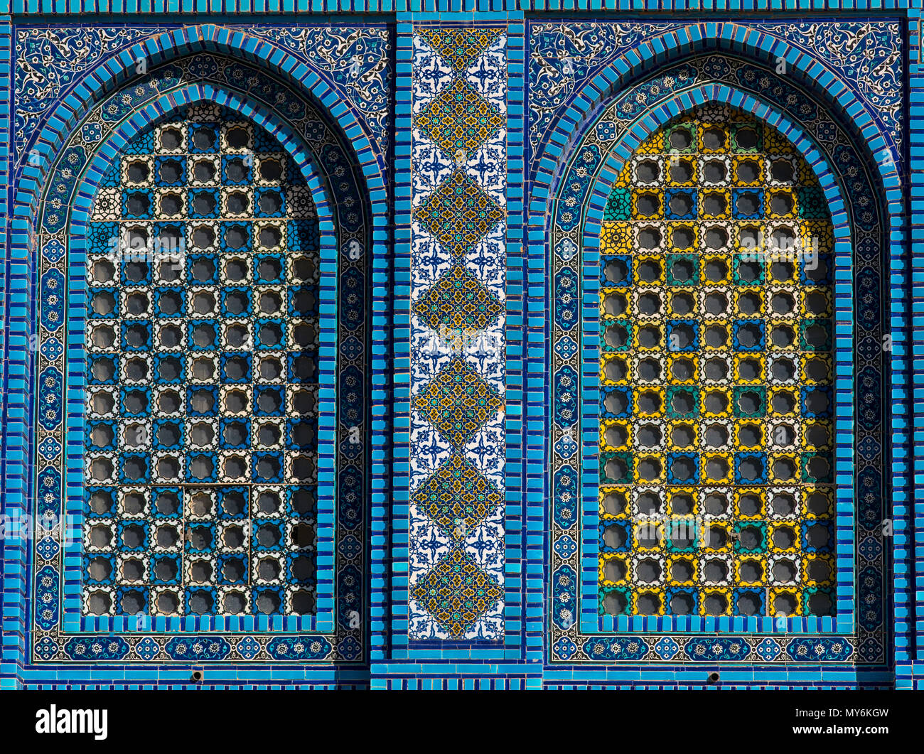 Colorful Islamic patterns, window covered with Arabic screen, mosaic ...